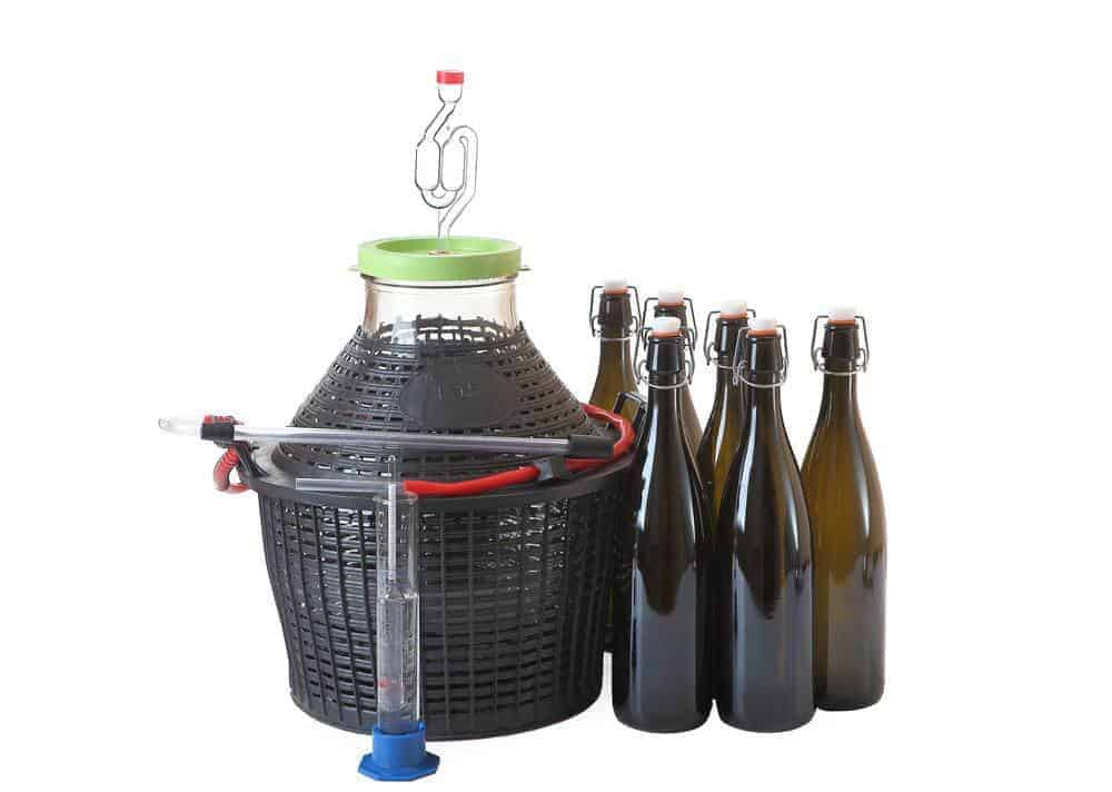 Utensils and Equipment For Making Wine At Home, on white.