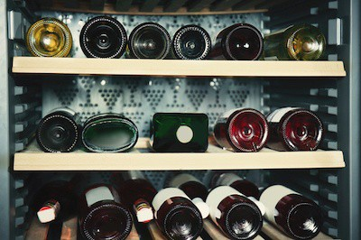 Wine bottles cooling in refrigerator