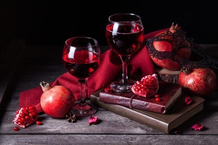 Pomegranate in wine glasses